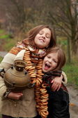 Young girls at autumn lanscape — Stock Photo
