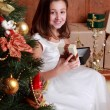 Little girl over Christmas tree — Stock Photo #35238119
