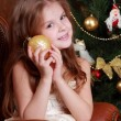 Young princess holding decorative golden ball — Stock Photo