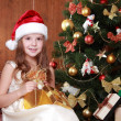 Little girl with Christmas present — Stock Photo