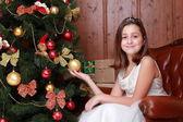 Little girl over Christmas tree — Fotografia Stock