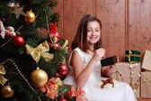 Little girl over Christmas tree — Stock Photo
