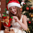 Little girl with Christmas present — Stock Photo #35240087