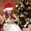 Stock Photo: Little girl with Christmas present
