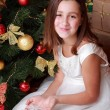 Little girl over Christmas tree — Stock Photo #35242151