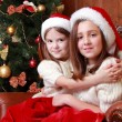 Cheerful little girls on Christmas — Stock Photo #35242169