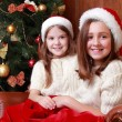 Cheerful little girls on Christmas — Stock Photo #35242233