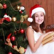 Little girl with books on Christmas — Stock Photo