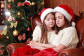 Cheerful little girls on Christmas — Stock Photo
