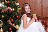 Little girl with candle on Christmas — Stockfoto