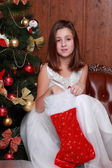 Little girl found a Christmas present in sock — Stockfoto