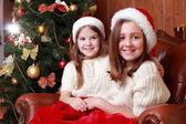 Cheerful little girls on Christmas — Stock Photo