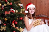 Little girl with books on Christmas — Stok fotoğraf