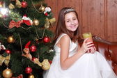 Little girl with candle on Christmas — Stock Photo