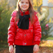 Little girl with maple leaves — Stock Photo