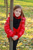 Little girl with maple leaves — Stockfoto