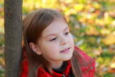 Little girl in autumn season — Stock Photo