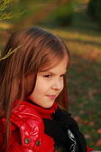Little girl at october month — Stock Photo