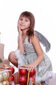 Little angel wearing silver dress — Stock Photo