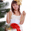 Little girl with Christmas tree — Stock Photo