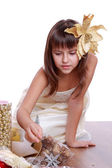 Girl with Christmas tree and gifts — Foto Stock