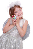 Little angel with decorative ball — Stock Photo