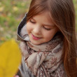 Little girl at autumn park — Stock Photo #35943825