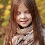 Girl in autumn time — Stock Photo #35944661