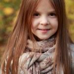 Girl in autumn time — Stock Photo #35944683