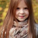 Girl in autumn time — Stock Photo #35944695