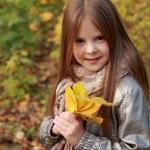 Girl in autumn time — Stock Photo #35944733