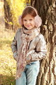 Little girl at autumn time — Stock Photo
