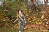 Girl running in autumn park — Stock Photo
