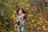 Kid running in autumn forest — Stock fotografie