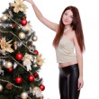 Girl decorate Christmas tree — Stock Photo #36136483