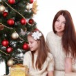 Mother and little on Christmas time — Stock Photo