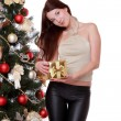 Foto Stock: Girl over fur tree