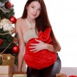 Woman holding presents on Christmas — Stock Photo