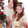 Mother and child girl in Santa hats — Stock Photo #36137845