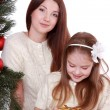 Mother and child girl in Santa hats — Stock Photo #36137861