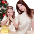 Mother and little girl on Christmas — Stock Photo #36137867