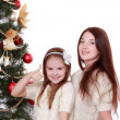 Mother and little girl on Christmas — Stock Photo #36137937