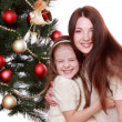Mother and little girl on Christmas — Stock Photo #36137939