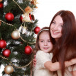 Mother and little girl on Christmas — Stock Photo #36137951