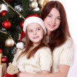 Mother and child girl in Santa hats — Stock Photo #36138091