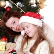 Mother and child girl in Santa hats — Stock Photo #36138113