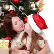 Mother and child girl in Santa hats — Stock Photo #36138115