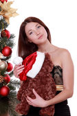 Woman and toy bear over Christmas tree — Stockfoto