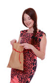 Woman holding Santa bag on Christmas — Stock Photo