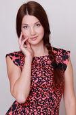 Woman wearing colorful dress — Stock Photo